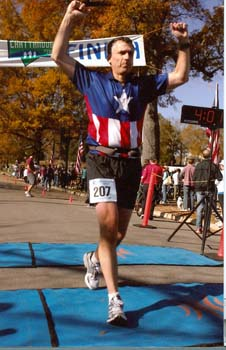 Tony finishing a 2009 marathon
