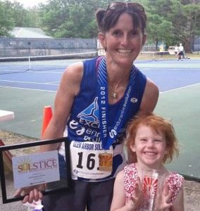 Krista and daughter Amelia at the 2012 Glen Arbor Summer Solstice Half Marathon. Krista was the top female finisher!