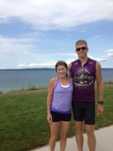 """Maggie and Chris in Petoskey at East Park. """"I've always wanted to bike from here to Charlevoix. We did the Mackinaw Multi-Sport Mix triathlon that morning, ran four extra miles together after the race, then rode 31 miles. Three cities in one day! Weekend warrior style!"""""""