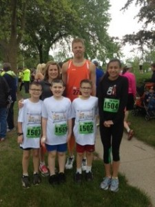 """Maggie and her family. """"This is the Midland 'Dow run' in May. My sons ran their first 5K (1502 and 1503). My daughter, Maija, ran a 2nd in age group 5K finish and Chris was third overall in the 10K. I ran with Caleb for his first 5K finish- the most rewarding race ever. It took him 46 minutes to finish, but he FINISHED!"""""""