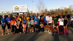 """Training consists of this many friends who meet at least two times a week at the Midland Brewing Co. that borders the Pierre Marquette Rail Trail. """"The Midland running community rocks!! We did an impromptu Run4Boston run."""""""