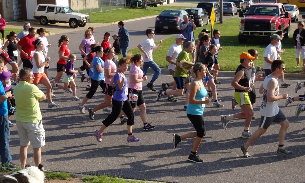 Sarah (in purple shirt and shoes) during a recent race. She is looking forward to running her first women-only race this weekend in Grand Rapids.
