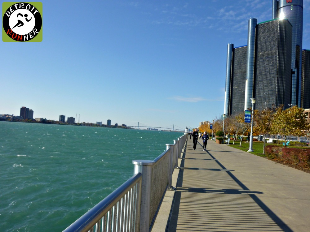 On the Riverwalk with the Ambassador bridge in the background and the Renaissance Center downtown.