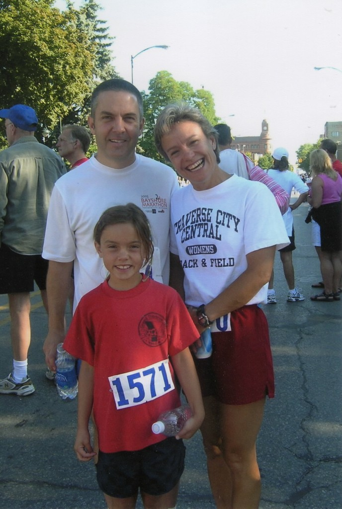 Lisa with her husband Dave and  their daughter Ellie, who runs on the high school level.