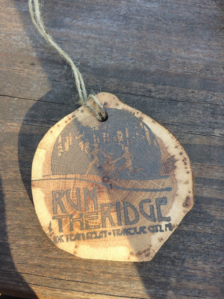 """Age-group winners received these cool wooden """"medals."""""""