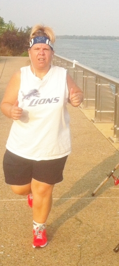 Tracy running the River Walk (on a hot and humid day) before a big Lions game earlier this fall.