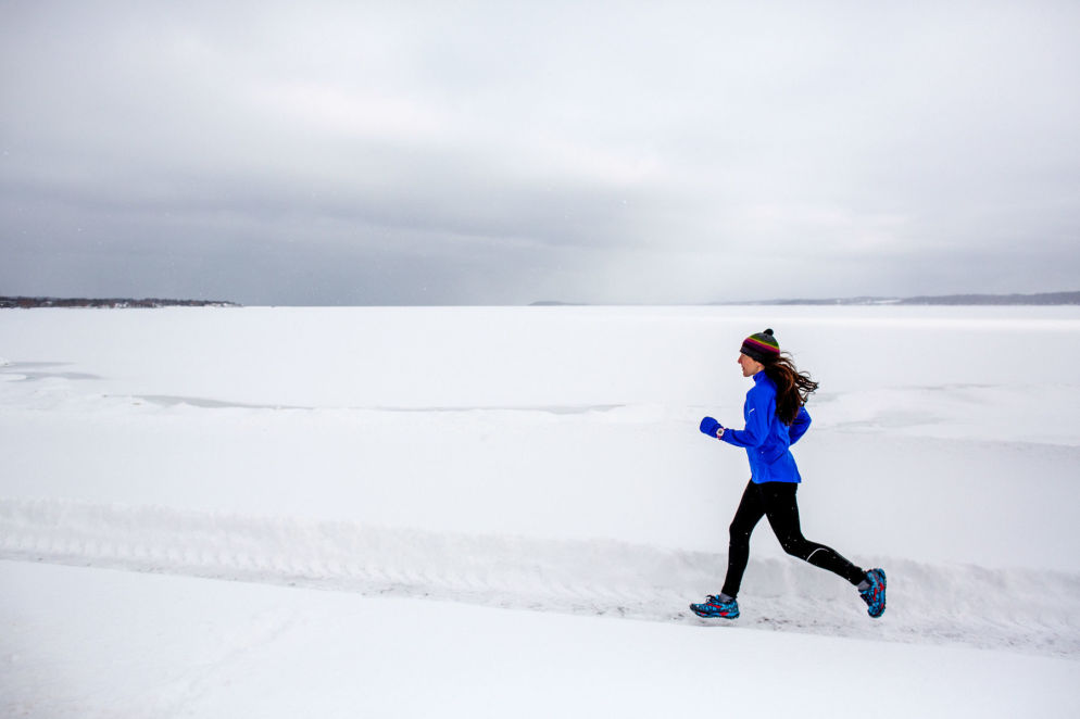 Running outdoors even on the coldest and snowiest of days can be a lot of fun. It's all about having the right clothing--and a great attitude. I love running outdoors in the winter, as this photo from 2014 suggests. Beth captured one of my training runs along West Grand Traverse Bay in Traverse City, MI. /Beth Price Photography