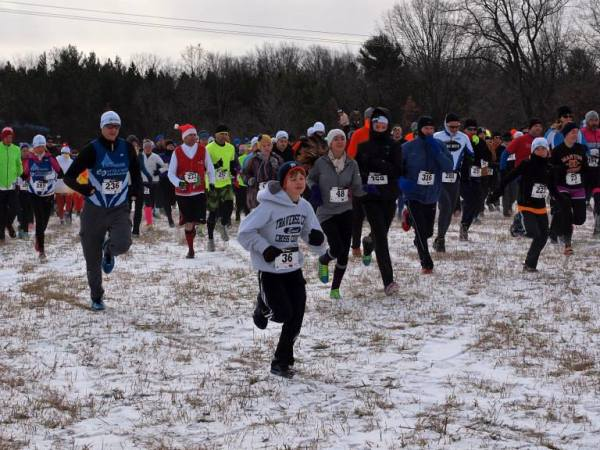 At the start of last year's Farmland 5K European Cross Country Challenge in Traverse City. That's Andrew in the great sweatshirt and dark blue Tigers hat. We love this winter race.
