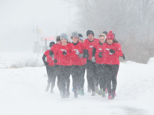 Members of Run Muskegon brave the elements during a group run last winter. Running outside all winter long is the focus of the latest Michigan Runner Girl podcast episode. /photo by Carlo Pozzobon.