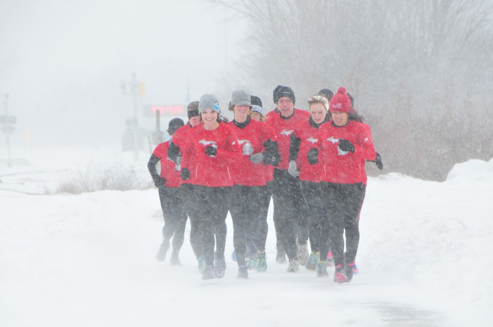 Members of Run Muskegon brave the elements during a recent group run. /photo by Carlo Pozzobon.