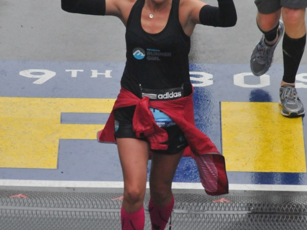 Crossing the finish line at the 2015 Boston Marathon!