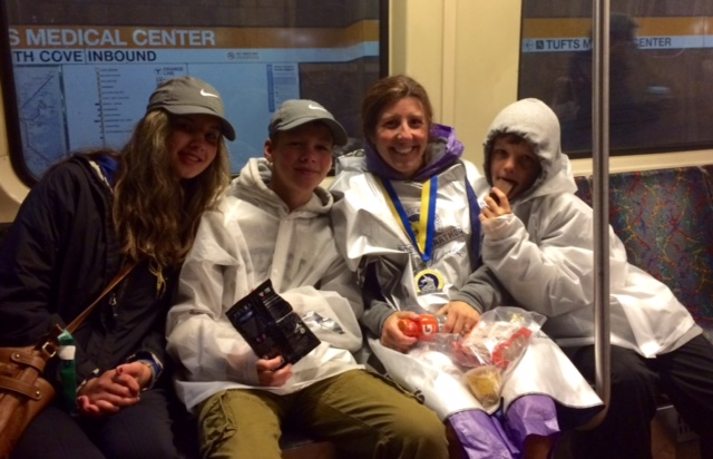 On the train after the race. Feeling very cold and wet, but so happy.