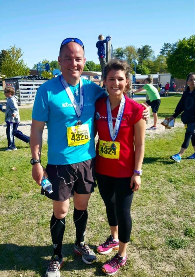 At the finish of the Bayshore Half Marathon with her dad, Bob Lajko.