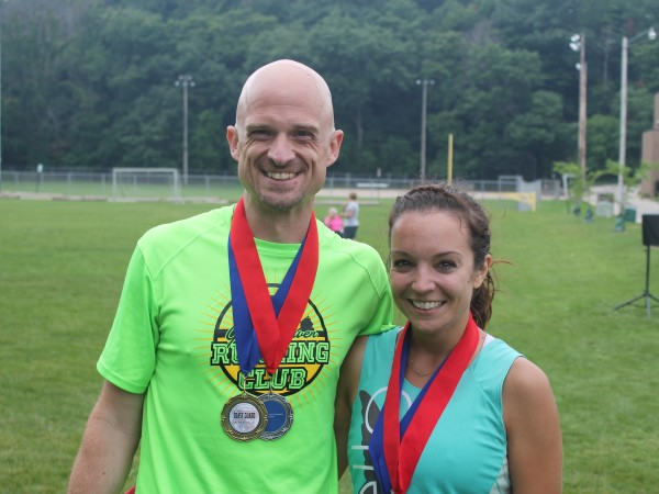 Steve and Courtney with their double medals after finishing the Coast Guard Festival Run 10K & 5K in Grand Haven last weekend. /photo courtesy Tasha Jablonski