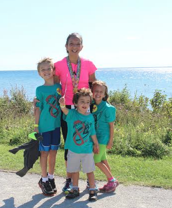 Mona and her three kids at last year's Mackinac 8 Mile Race.