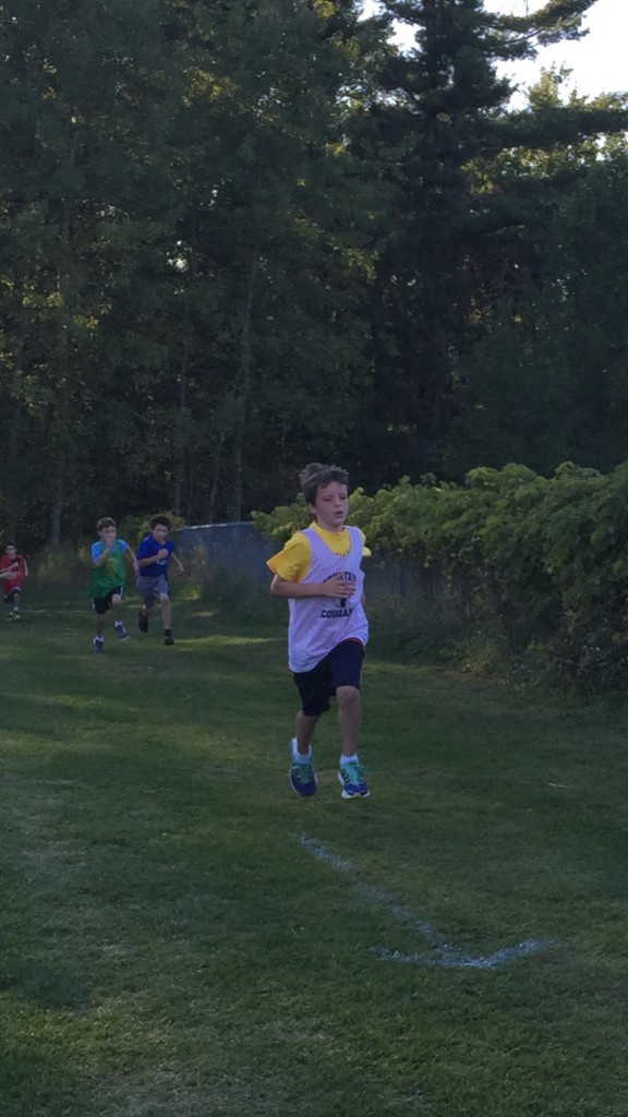 Alex, 9, running the mile at his first-ever cross country race.