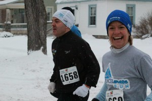 Lisa and her husband Dave running a 5K together in Traverse City.