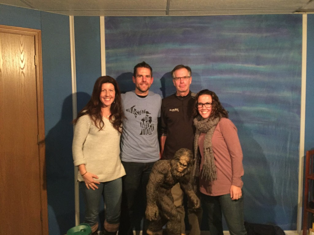 The snowshoe podcast crew: (left to right) Heather, Jeb, Jeff and Cassy. (And The Sasquatch, front and center)