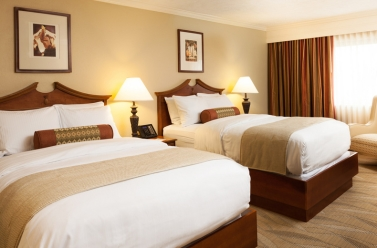Traditional Style Hotel Room with two double beds. Our six-story hotel offers 237 spacious guest rooms, with wireless high-speed Internet access. Conveniences include: inroom coffee and hair dryers.