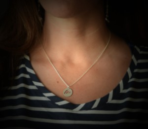 "Heather is wearing the charm on the 18"" sterling silver chain. The charm is hand-cut and made here in Michigan, by artist Kirsten Jones (Heather's sister!)"