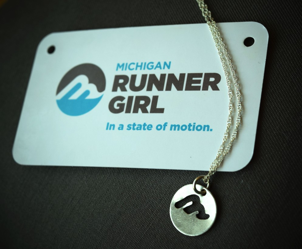 "The Michigan Runner Girl Charm Necklace: hand-cut and made in Michigan by Traverse City artist Kirsten Jones. The charm may be bought separately or with an 18"" sterling silver chain."