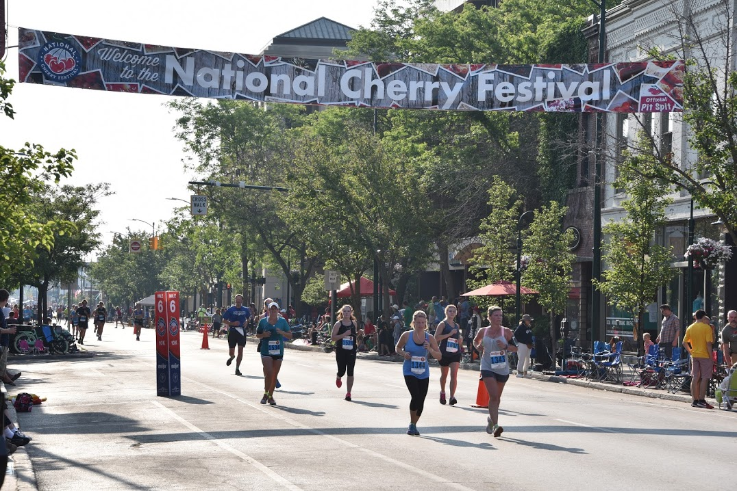 Finishing your race in downtown Traverse City is super fun -- the street is closed for the big end-of-festival parade later in the day, and parade-goers are already there and love cheering on runners.