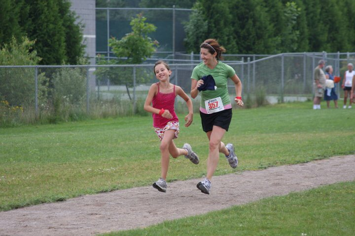 Emma and me, running a local 5K together in 2010. She was in 5th grade and I was early on in my running and racing.