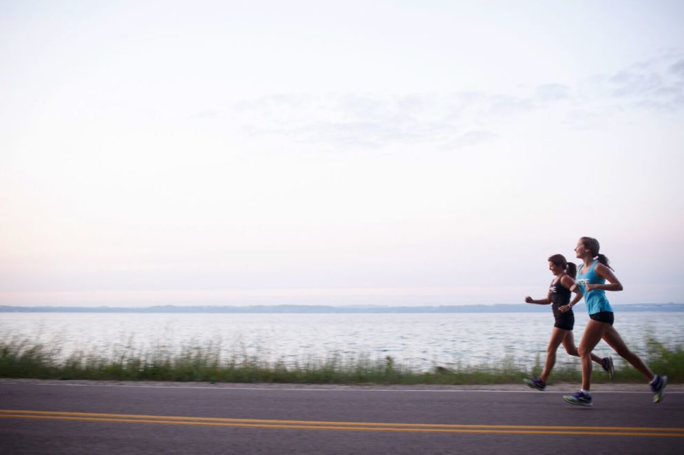 Emma and me on Bluff Road last summer. This is part of the Bayshore Marathon and Half Marathon course. 2015. /Photo by Beth Price of bethpricephotography.com (thank you, Beth, for capturing this moment for us.)
