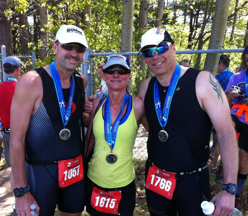 Miranda with running friends Walt and Martin at the 2015 Bayshore Marathon, where she qualified for Boston.