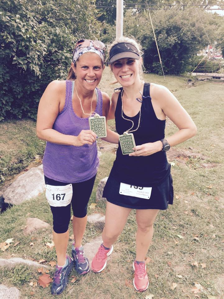 Runners at the Vineyard to Bay, showing off their tile art finisher medals. /Photo courtesy Vineyard to Bay 25K.