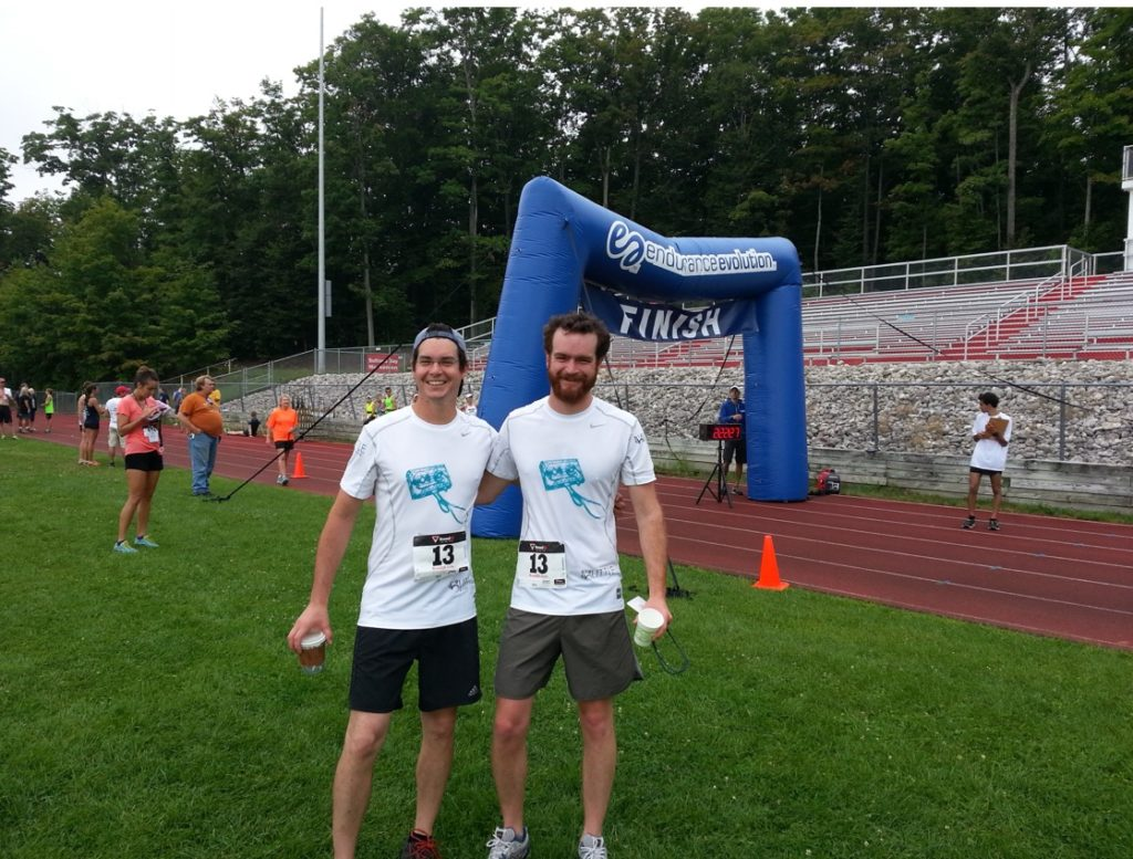 Brothers Mike and Pete Laing at the finish of the Vineyard to Bay 25K in Suttons Bay. The brothers, who operate Big Little Wines and help sponsor the August race each year, also have completed the 25K relay together.