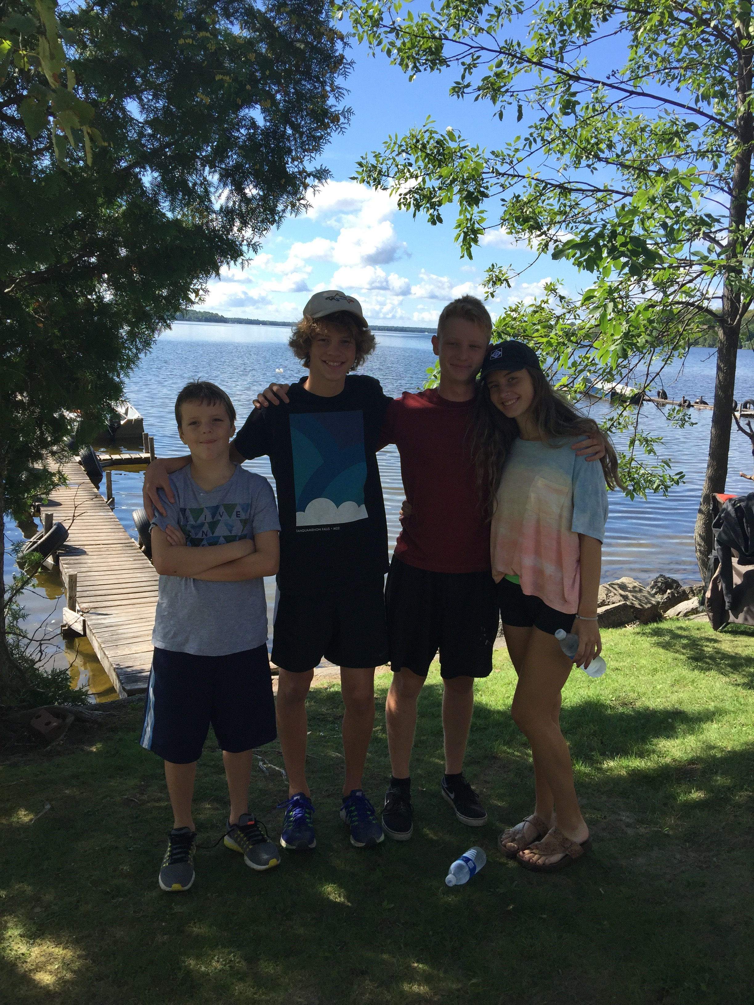 (From left) Alex, Andrew, Isaac (Emma's boyfriend), and Emma. I love this photo of these guys in front of our cabin!