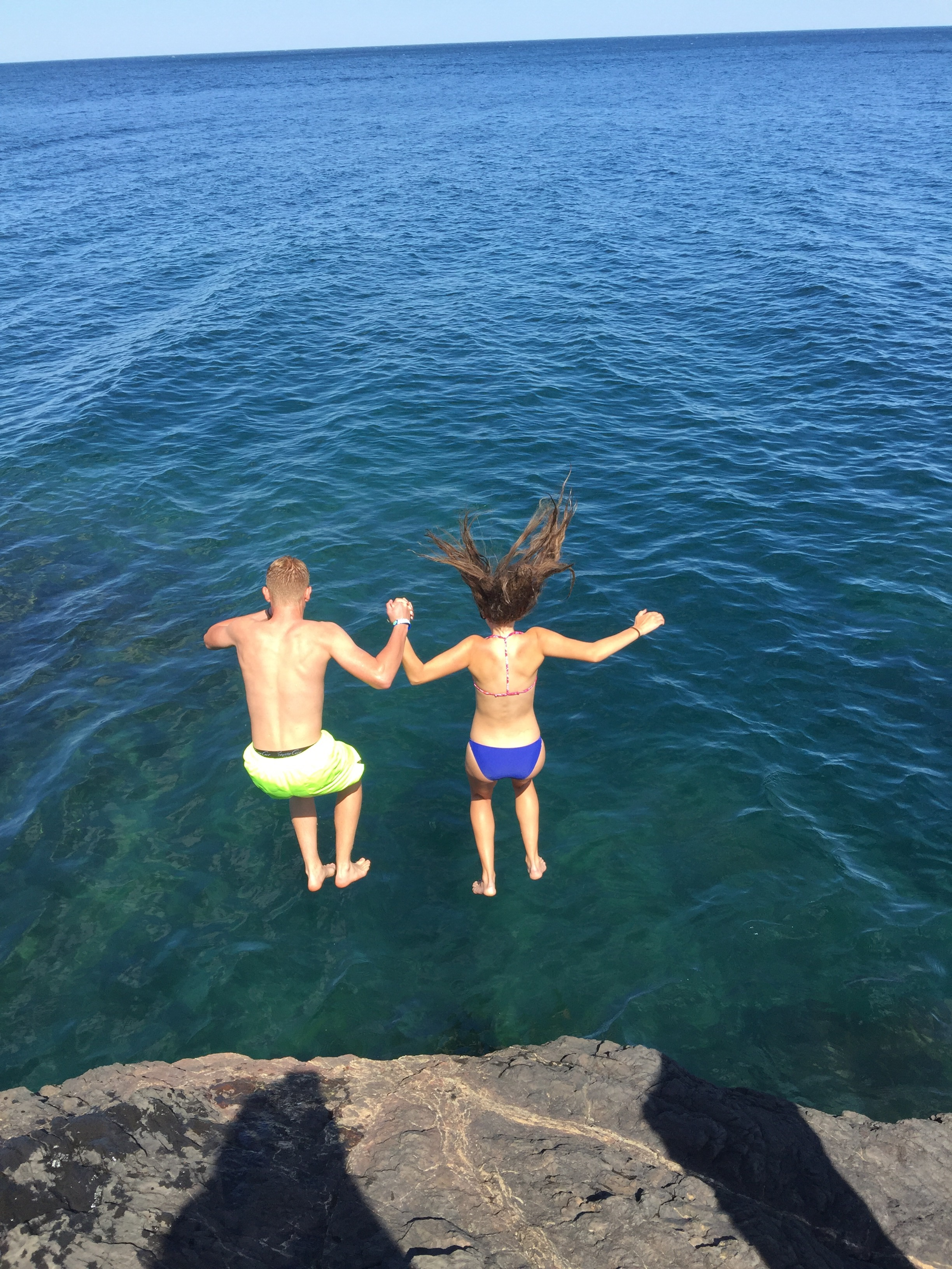 Emma and Isaac, jumping off Black Rocks into the refreshingly cold Lake Superior waters!