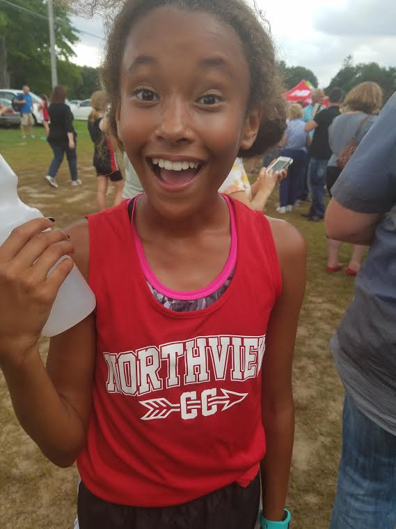 Amara, 12, at her first cross country meet this year.