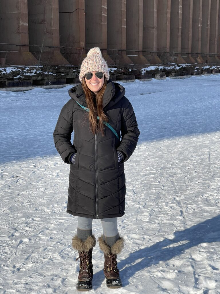 Heather wearing a Harper parka in Marquette